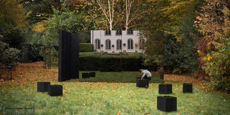 Kyson از ترکیب چوبهای سوخته و شیشه های دودی برای ساخت پاویون در باغ استفاده کرده است