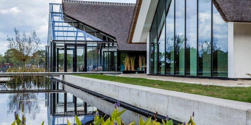 طراحی گلخانه شیشه ای با ترکیب کلبه کاهگلی / طراحی شرکت Maas Architecten